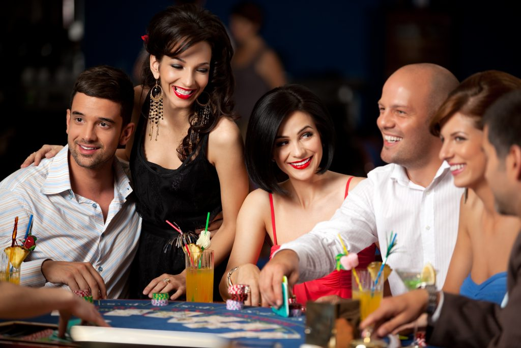 Friends playing at Blackjack tables