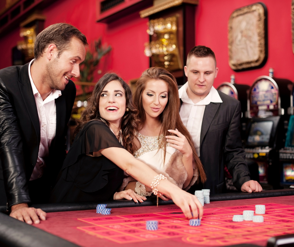 group playing roulette games at casino